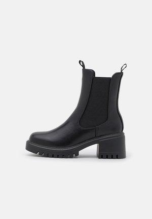 MARILYN - Kotníkové boty na platformě - black