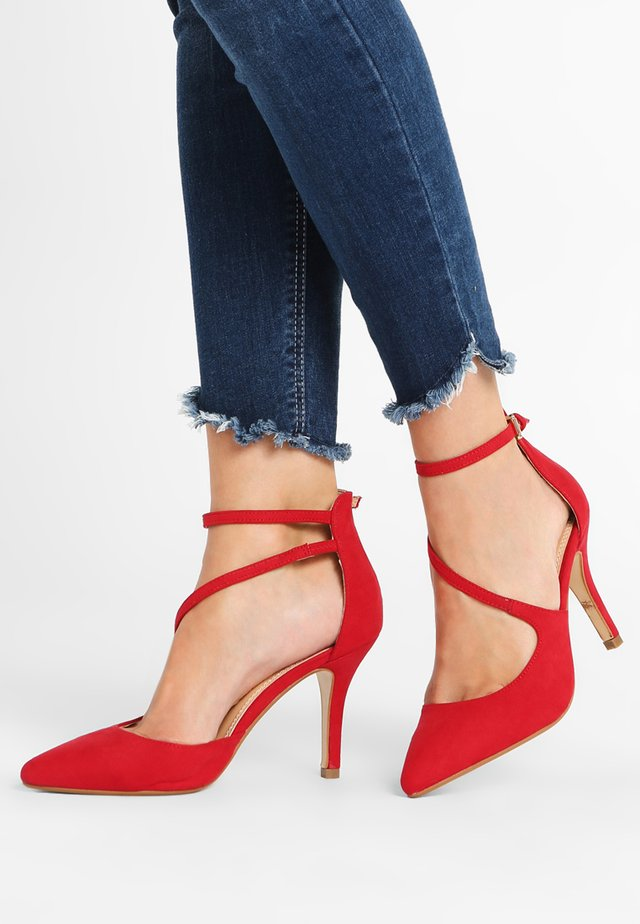 Højhælede pumps - red