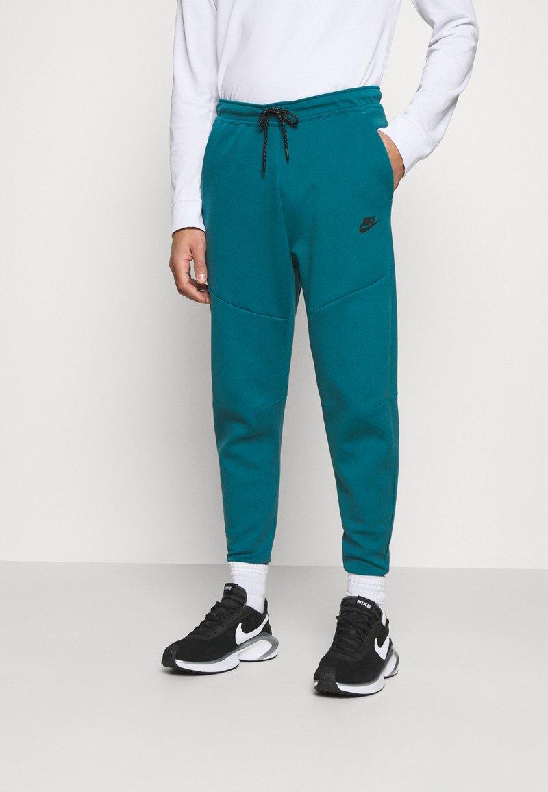 Nike Sportswear - TONE - Tracksuit bottoms - dark teal green/blustery