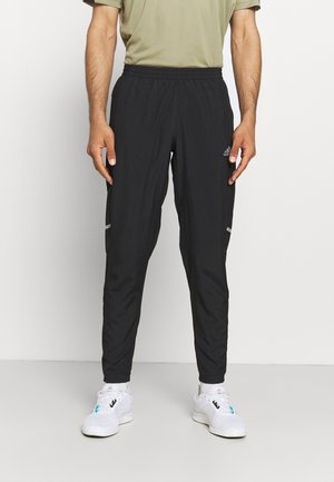 OWN THE RUN PAN - Tracksuit bottoms - black