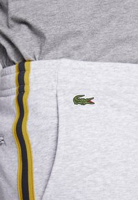Lacoste - Tracksuit bottoms - silver chine/jonquille-black - 4