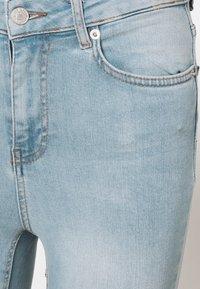 NA-KD Tall - HIGH WAIST RAW - Jeans Skinny Fit - light blue - 2