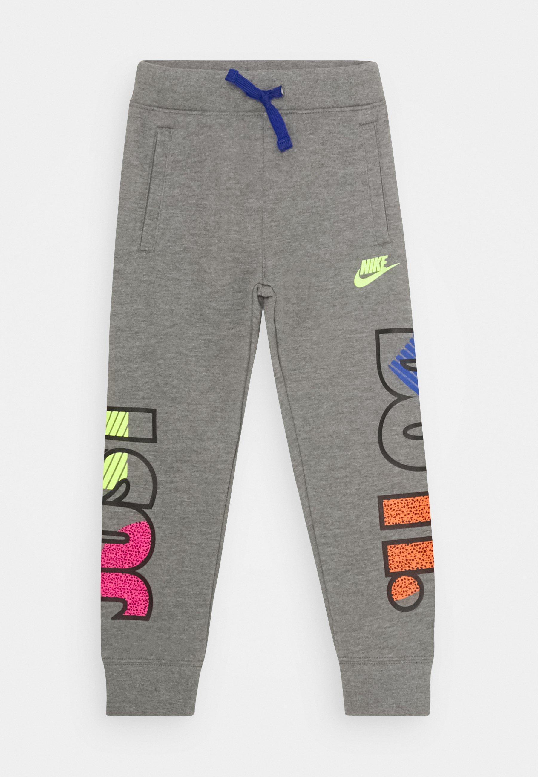 tierra Roca innovación  Nike Sportswear JDI FLY JOGGER - Pantalon de survêtement - carbon  heather/gris chiné - ZALANDO.FR