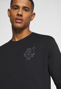 YOURTURN - UNISEX - Long sleeved top - black - 4