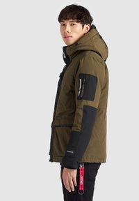 khujo - NANDU - Winter jacket - oliv-schwarz kombo - 2