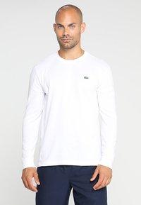 Lacoste Sport - Funkční triko - white - 0
