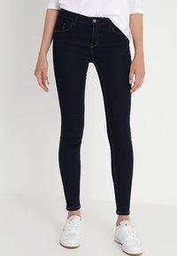 ONLY - ONLDAISY PUSHUP - Jeans Skinny Fit - dark blue denim - 0