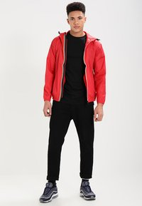 K-Way - CLAUDE 3.0 UNISEX  - Summer jacket - red - 1