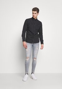 Jack & Jones - JJESHERIDAN SLIM - Shirt - black denim - 1