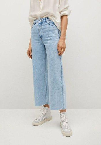 CAROL - Flared Jeans - light blue