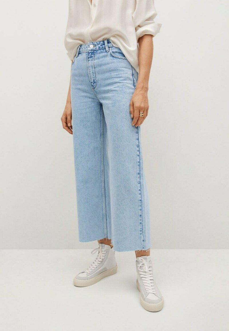 Mango - CAROL - Flared Jeans - light blue