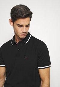 Tommy Hilfiger - Polo shirt - black - 3