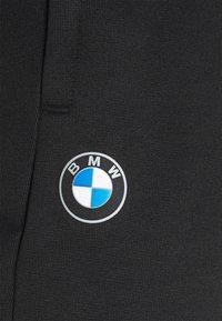 Puma - BMW TRACK PANTS - Tracksuit bottoms - black - 7