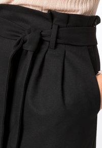 HALLHUBER - PAPERBAG-ROCK - Pencil skirt - black - 0