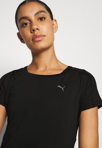 Puma - TRAIN FAVORITE TEE REGULAR FIT - Camiseta básica - black - 3