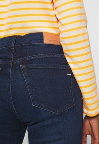 Marc O'Polo - TROUSER - Slim fit jeans - dark blue base wash - 5