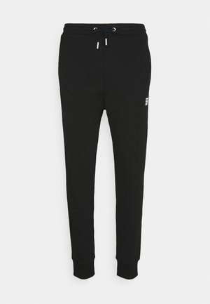 P-TAR-KA TROUSERS - Tracksuit bottoms - black