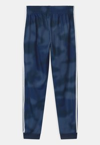 adidas Originals - CAMO SUPERSTAR UNISEX - Tracksuit bottoms - crew blue/white - 1