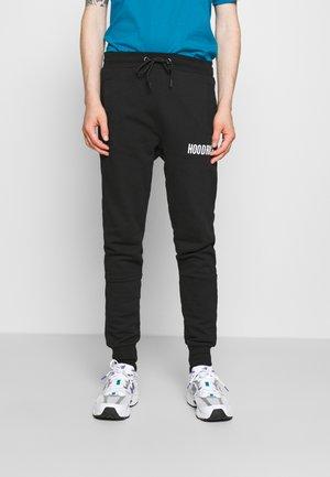 CORE - Tracksuit bottoms - black