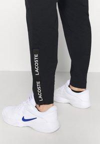 Lacoste Sport - NAMING TRACK PANT - Teplákové kalhoty - black/white - 3