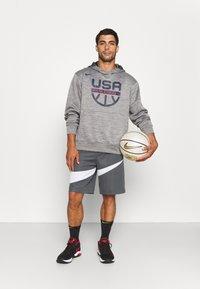 Nike Performance - TEAM USA SPOTLIGHT HOODIE - Sweatshirt - dark grey heather/dark grey - 1