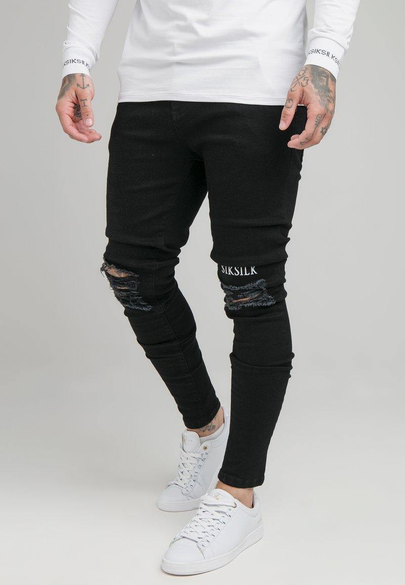 SIKSILK - RAW HEM BURST KNEE - Jeans Skinny Fit - black