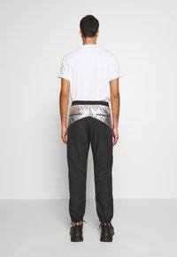Just Cavalli - PANTS - Pantaloni sportivi - black/silver - 2
