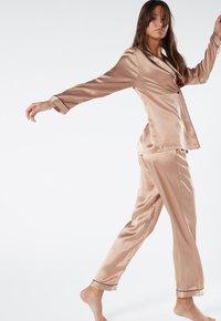 Intimissimi - LANGE HOSE AUS SATIN UND SEIDE - Pyjama bottoms - rose satin - 1