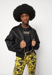 Versace Jeans Couture - LADY - Triko spotiskem - black - 3