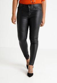 ONLY Carmakoma - CARPUNK SKINNY BIKER COATED  - Trousers - black - 0