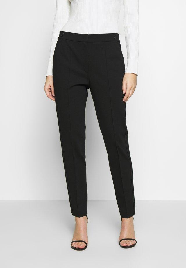 TUNTA - Pantalones - black