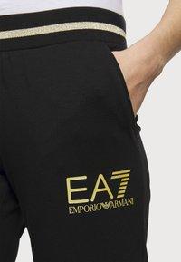 EA7 Emporio Armani - Tracksuit bottoms - black - 3