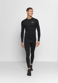 Nike Performance - PRO TIGHT MOCK - Sports shirt - black/white - 1