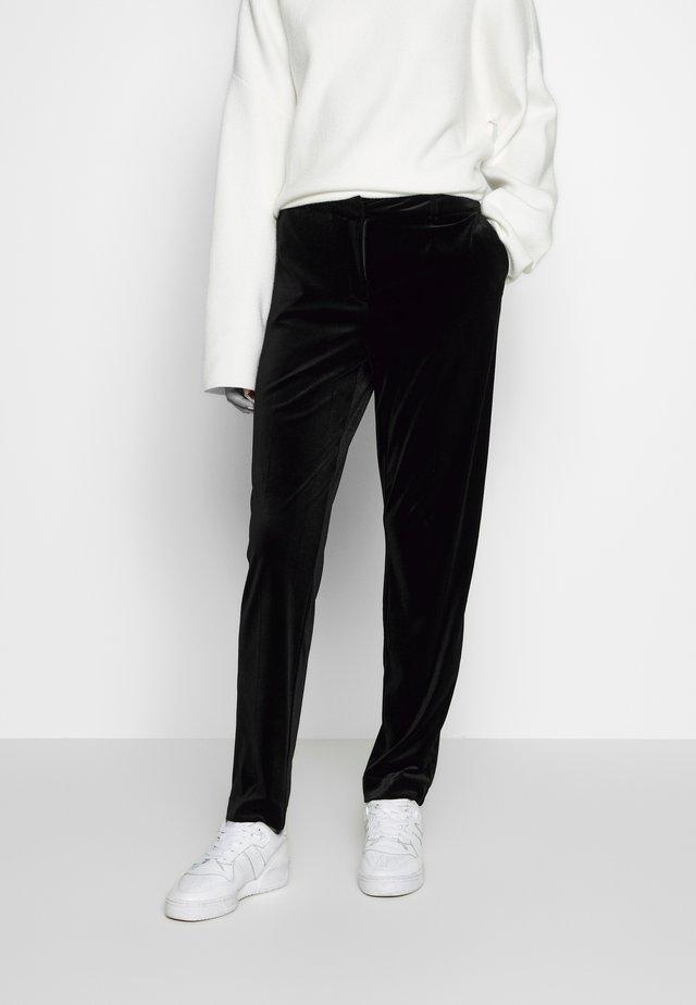 ANKLE GRAZER - Trousers - black