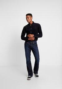 Tommy Jeans - RYAN  - Bootcut jeans - lake raw stretch - 1
