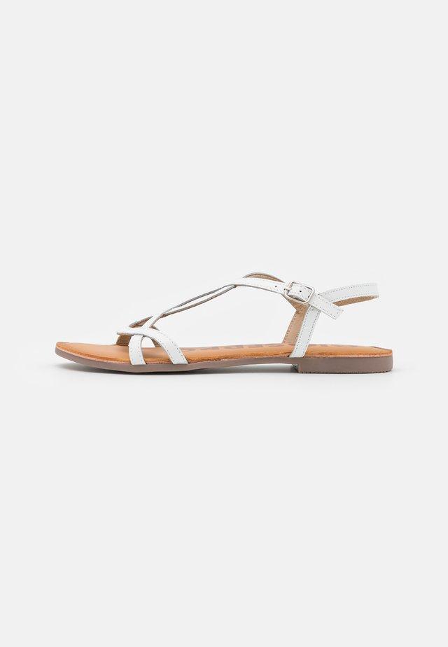 Sandaalit nilkkaremmillä - blanco