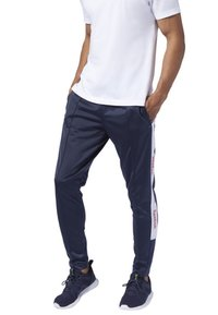 Reebok - TRAINING ESSENTIALS LOGO TRACKSTER PANTS - Tracksuit bottoms - blue - 0