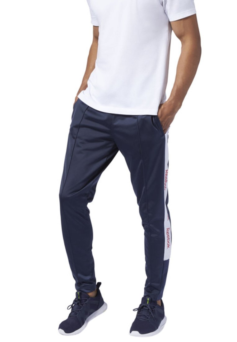 Reebok - TRAINING ESSENTIALS LOGO TRACKSTER PANTS - Tracksuit bottoms - blue