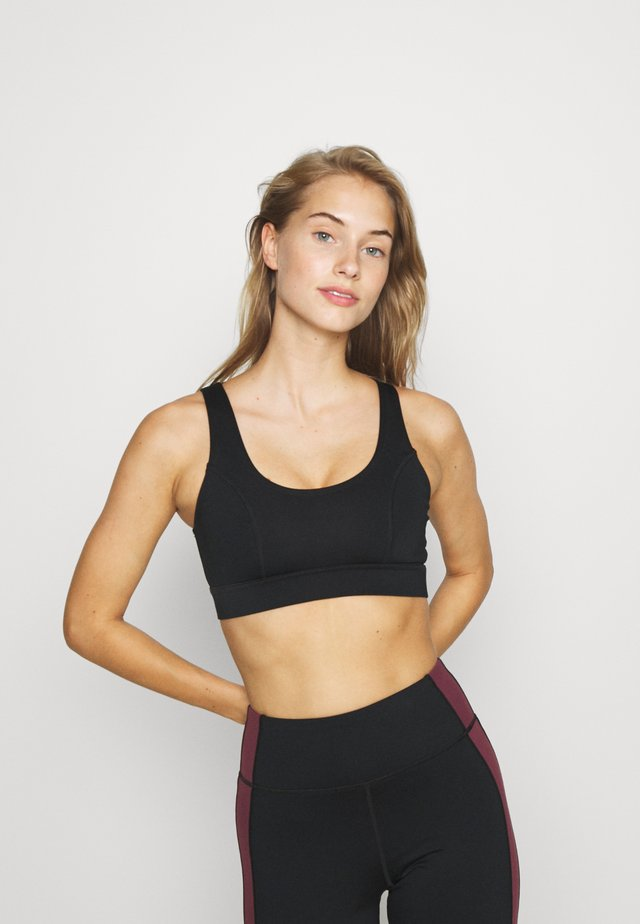 PANEL HIGH NECK SPORTS BRA CORE - Sports bra - black