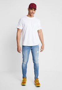 Redefined Rebel - STOCKHOLM DESTROY - Slim fit jeans - soft blue - 1