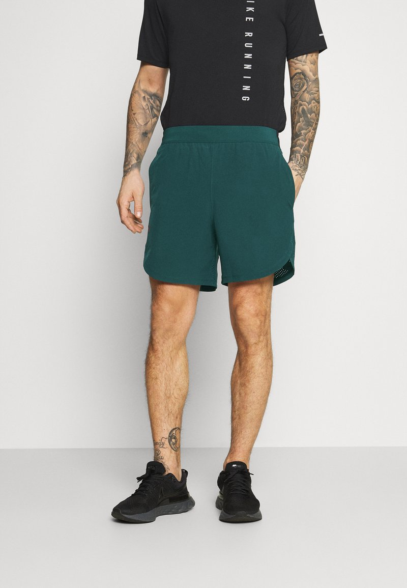 Under Armour - SHORTS - Sports shorts - dark cyan