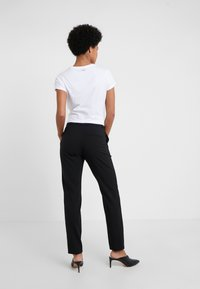 HUGO - Trousers - black - 2