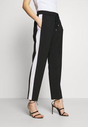TULIPAKA - Pantaloni sportivi - black