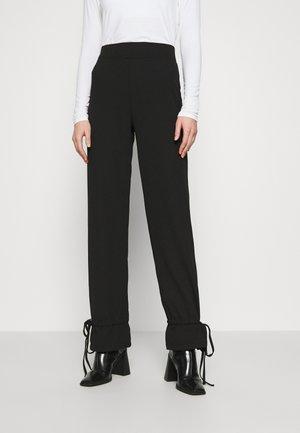TIE PANTS - Trousers - black