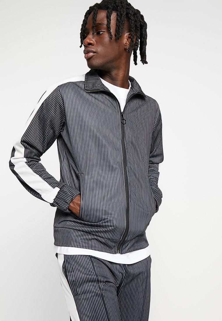 Night Addict - RAIN - Training jacket - black/white