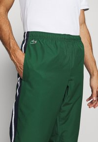 Lacoste Sport - Tracksuit bottoms - green - 6