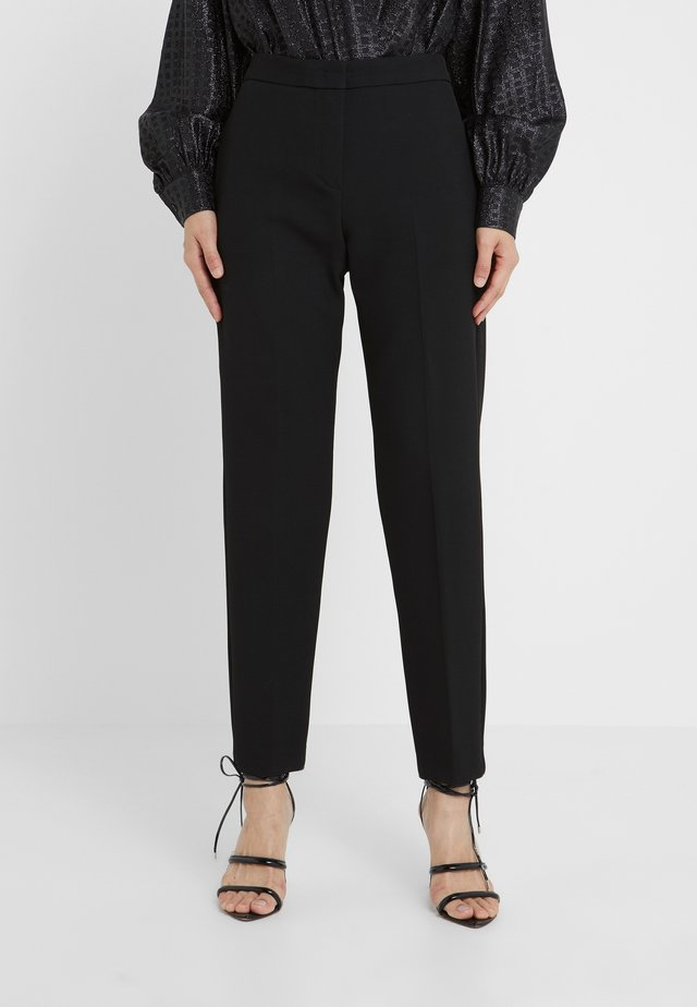 CARMINIO - Pantalones - black