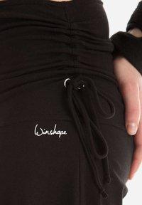 Winshape - Tracksuit bottoms - black - 6
