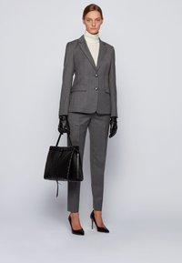 BOSS - TILUNI - Trousers - grey - 1
