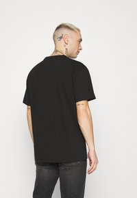 Tommy Jeans - SHINE SMALL TEXT TEE UNISEX - T-shirts print - black - 2